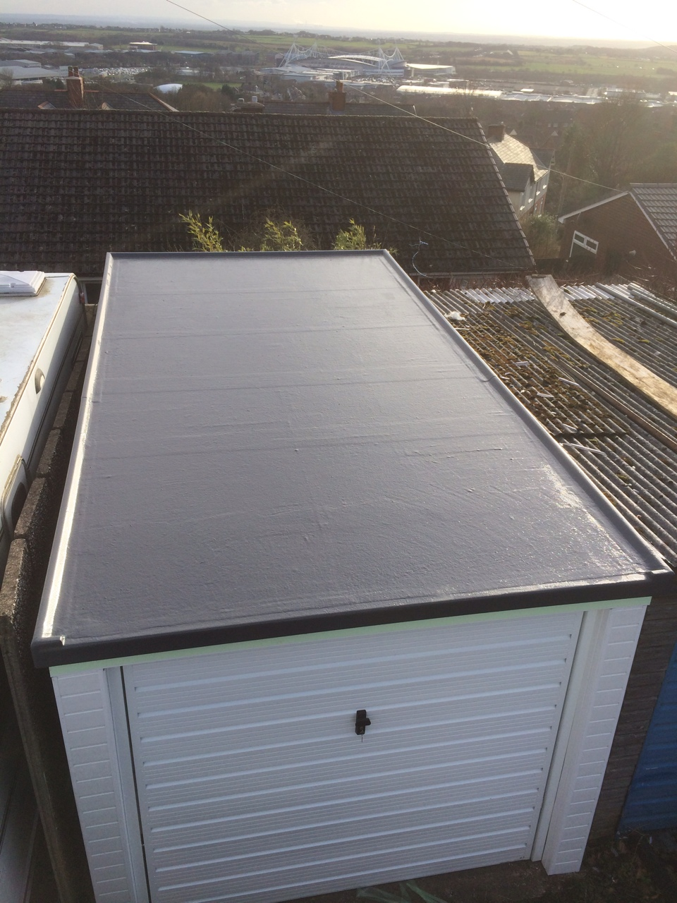 image shows grp roofing on a garage in wigan
