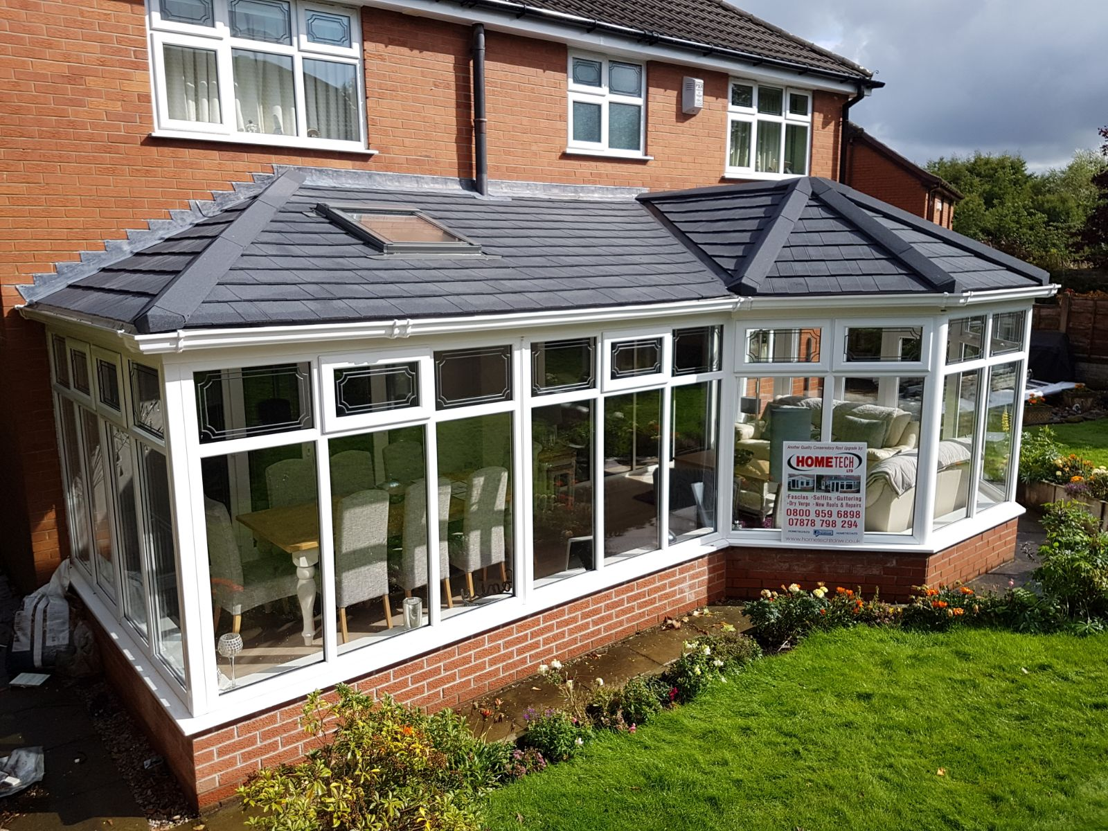 image showing conservatory with advertisement to contact a roofer in wigan